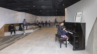 The open space in H6 CONET provides a piano for public enjoyment.