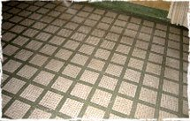 The floor is covered with white mosaic tiles of the 1940's decorated with green and dark red tessera.